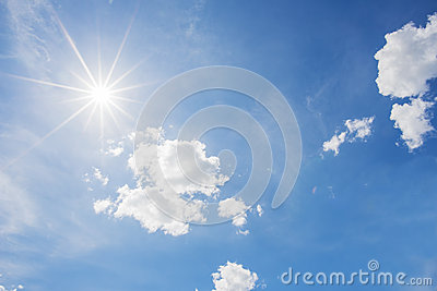 Blue sky and cloud with bright sun star flare background