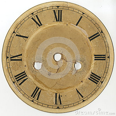 The dial of the old clock with Roman numerals and without arrows, with holes for the mechanism and keys of plant and translation.