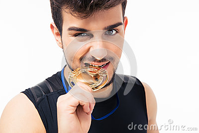 Sports man biting medal