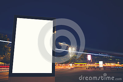 Modern billboard on the bustling streets of the night city