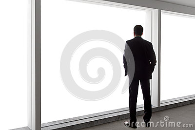 Businessman Looking Out a Big Window