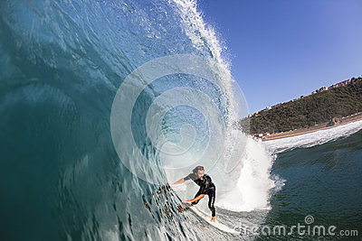 Surfer Surfing Inside Wave