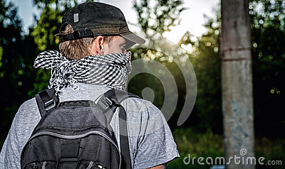 Man covering face with a scarf