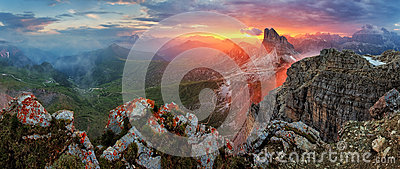 Panorama dramatic sunset in dolomites alp mountain from peak Nuv
