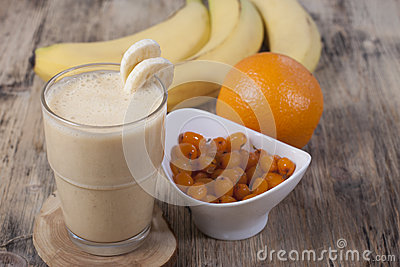 Smoothie of banana, orange juice , frozen sea-buckthorn   with y