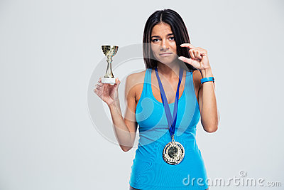 Sports success woman with medal