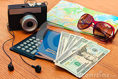 Travel set passport money  blank notebook camera road map sunglasses calculator, headphones. Summer accessorie
