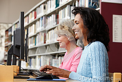 Women working on computers in library