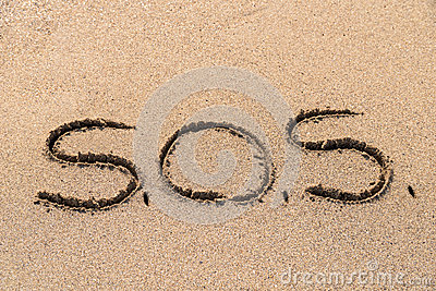 SOS Sign Drawn On Sand