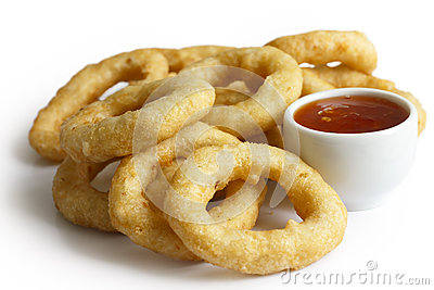 Heap of deep fried onion or calamari rings with chilli dip isola