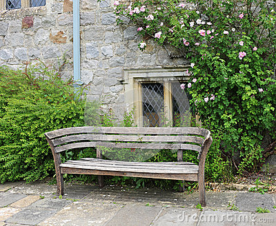 Bench seat in an english garden in early Summer