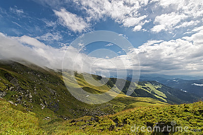 Beautiful lansdcape with blue cloudy sky in Rodnei mountains
