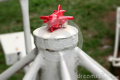Toy plane with a red propeller.