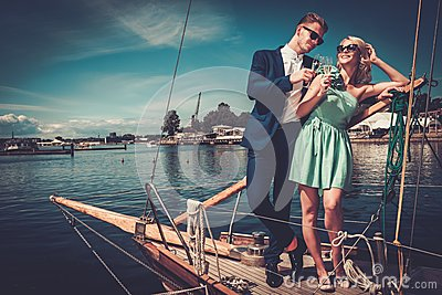 Stylish couple on a luxury yacht