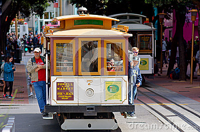 stock image of passengers riding on powell-hyde line cable car in san francisco
