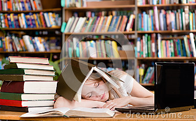 Pretty female student sleep in library