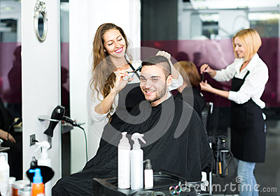 Hairdresser making haircut in hair studio