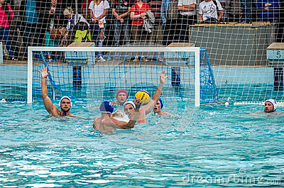 Lviv, Ukraine - July 2015: Ukrainian Cup water polo. Athlete team's water polo ball in a swimming pool and makes attacking shot on