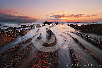 Flysch rocks in barrika beach at sunset