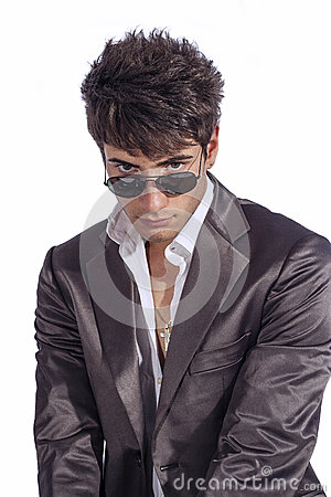 Young trendy guy. Italian man with sunglasses and open white shirt