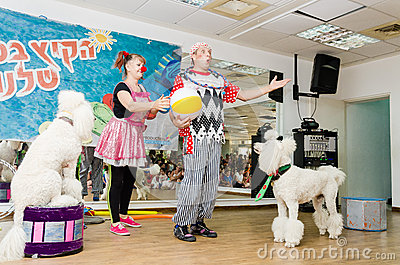 Beer-Sheva, ISRAEL - Clowns and two white poodle- July 25, 2015