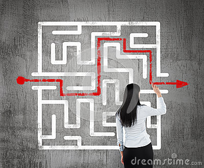 Business woman finding the solution of a maze.