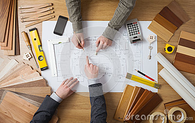Businessman and construction engineer working together