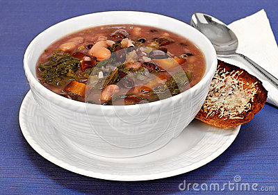 Kale, bean and vegetable soup close up.