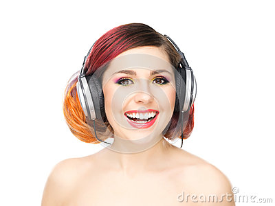 Beautiful girl listening to the music throughout headphones