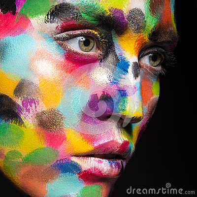 Girl with colored face painted. Art beauty image