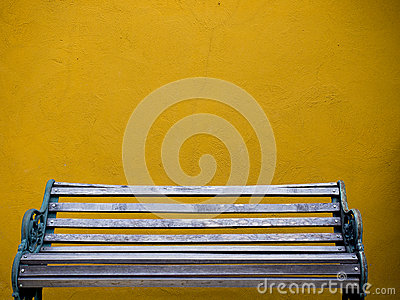 Wooden chair and yellow wall