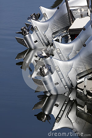 Close up of four outboard boat motors