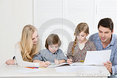 Happy family drawing together