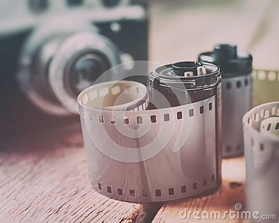 Old photo film rolls, cassette and retro camera