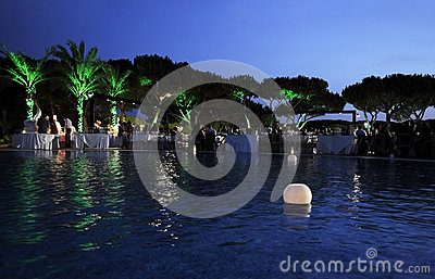 Lighted Candles on Pool, Dinner Party, Dusk Scene