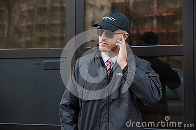 Security Guard In Front Of The Door Entrance