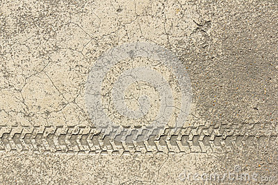 Wheel print of bicycle on cement texture