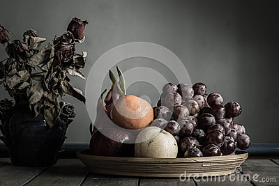 Fruit in old wooden tray.