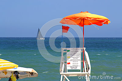 Red flagged lifeguard tower