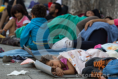 Refugee child sleeping at Keleti train station in Hungary