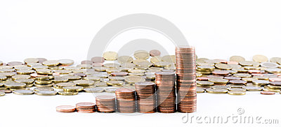 Euro currency coins building a scale and euro coins spread on a white background