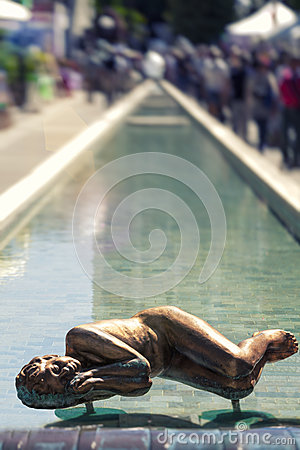 Spa long fountain of Abano Terme in Italy. Statue sleeping in water