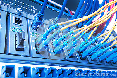 Fiber Optic cables and UTP Network cables connected hub ports.