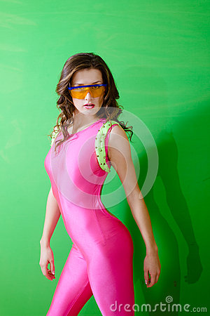Fitness girl wearing pink lycra jumpsuit and