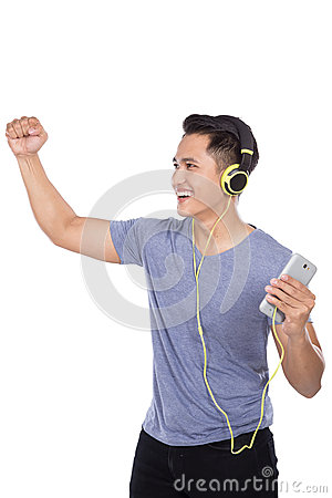 Young asian man listening to music with a headset