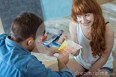 Couple going to painting walls