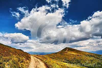 Landscape mountains field of green fresh grass under blue sky