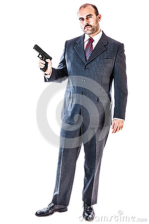 Intimidating man in suit with gun