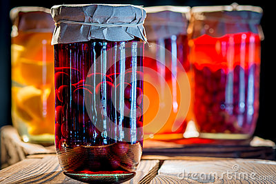 Compote of cherries in a glass jar