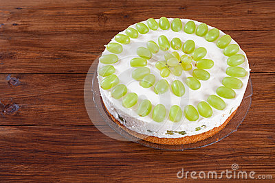 Grape torte with green grapes on cake plate